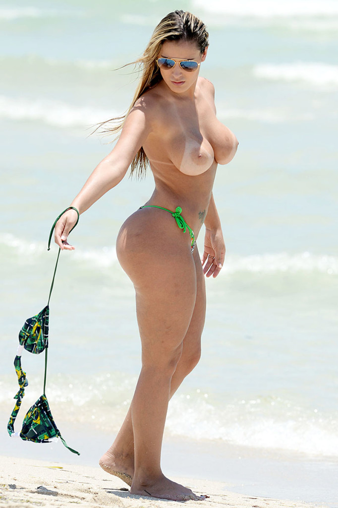 *WARNING: CONTAINS NUDITY* Brazilian Miss Butt Andressa Urach heats up the beach in Miami